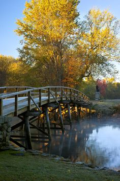 "Historic Old North Bridge, Concord, Massachusetts. A historical site in the Battle of Concord, the first day of battle in the American War of Independence. The current wooden pedestrian bridge is a replica of the one that stood at the day of the battle. Part of the Minute Man National Historic Park. A line from Ralph Waldo Emerson's 1837 'Concord Hymn' is ""Here once the embattled farmers stood  And fired the shot heard round the world""."