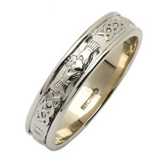 Claddagh & Celtic Knot White Gold Narrow Wedding Band - Claddagh Wedding Rings - Rings from Ireland. This exquisite ring incorporates two wonderful Irish designs side by side; the iconic Claddagh symbol and intricate Celtic knot-work made famous by the fine examples found in the Book of Kells.   The Claddagh emblem is a very significant Irish symbol of love with the heart representing 'true love', the joining hands meaning friendship and all brought together by the crown of loyalty.