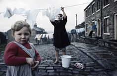 Woman hanging out wash, Northern UK, ca. 1960. Photo by John Bulmer.