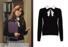 Jess Day (Zooey Deschanel) wears this black sweater with white bow detail in season 4 episode 5 of New Girl.