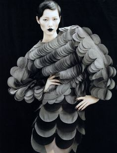 Avante Garde Fashion Couture. An amazing layered piece of circles. Following the shape of the body and gradually increasing in size. I love the layered effect to the shapes.