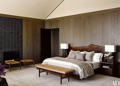Distressed oak paneling lines the master suite, which is anchored by a George Nakashima Woodworker bed.