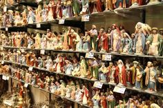 Walking in Via San Gregorio Armeno    Guaranteed to put you in the holiday mood, from early December this Naples street is chock-a-block with twinkling shops and stalls selling artisan-made Christmas crib figurines.    Photo Caption: Nativity figurines for sale along Via San Gregorio Armeno in Naples, Italy.    Photo by john_myers/Flickr.com
