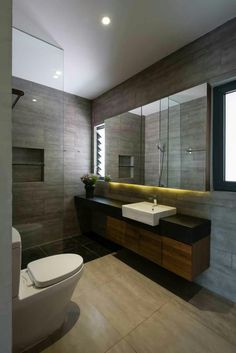 soft grey stone tiles, continuous timber vanity/bath base and