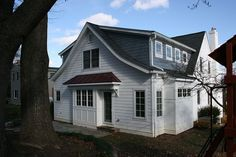 This 1940's Cape Cod got a 2 story addition and extensive interior remodeling. See the picture gallery. Built by Old Dominion Building Group in N VA.