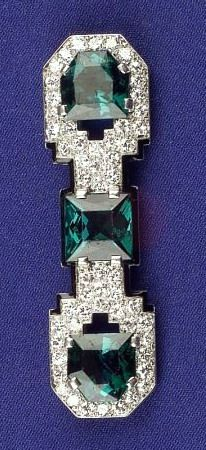 "Art Deco Platinum, Green Tourmaline, Diamond and Enamel Brooch, Cartier, prong-set with fancy-cut tourmalines, pave-set diamond mount with black enamel accents, 2 x 1/2 in., signed ""CARTIER"" 3597."