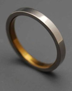 Sleek Titanium and Bronze Inlay Ring, $135 | 34 Unconventional Wedding Band Options For Men