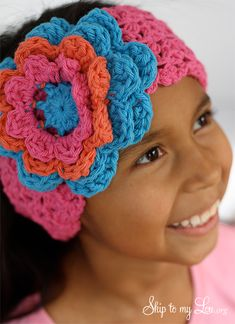 Pattern for how to crochet an ear warmer with a flower accent. Great holiday gift idea.