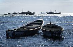 Mauritania, Nouadhibou . Wooden fishing boats off the coast of Nouadhibou