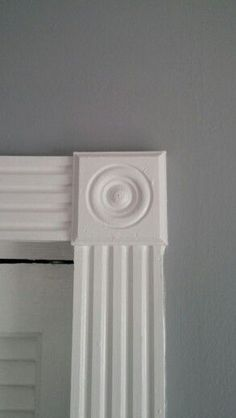 beautiful rosettes and wood trim framing every window and door & bullseye rosette and fluted molding door casing | Bathroom Ideas ...