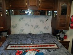 Motorhome - Bedroom pic during remodel - mirrored headboard and frame removed and look more blue flowers to paint over