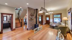Hello light fixture!!! transitional living room by HighCraft Builders