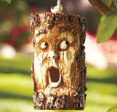 Absolutely unique, a Wood-Look Character Birdhouse will give any tree personality. It looks like a face carved on a wood log. To enter and exit the house, birds Bird House Feeder, Bird Feeder, Lakeside Collection, Bird Cages, Yard Art, Bird Feathers, Beautiful Birds, Wood Carving, Bird Houses