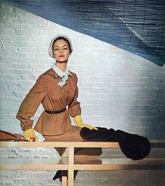 Jean Patchett in butterscotch suit with a skirt shaped jacket, photo by John Rawlings, Vogue Feb. 1950