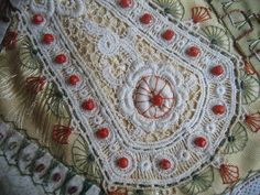 "I ❤ crazy quilting, beading & embroidery . . . ""Just awesome"" Detail. The red coral beads from my bracelet. ~By Margreet from Holland"