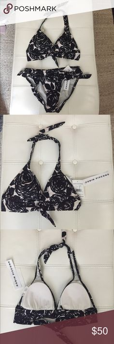 Robin Piccone Floral Bikini NWT never worn bikini. Blk/ecru colorway. Top is size XS and bottom is size S. removable padding at bra. Tie closures at neck and back top. Robin Piccone Swim Bikinis