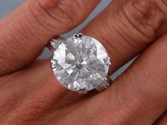 """7.25 Carats Total Weight; Center Stone 7.13 carats; Accent diamonds 0.12 cts; Color: H - Clarity: SI3-I1 - """"***Slight Haze***""""  The photo shows a BIG Haze!  Buyer beware.  There's a reason this 7.25 ct ring is only $23,990.00.  I'm looking for a 7-8 carat marquise or pear & would never buy one w/these qualities no matter how inexpensive, it'd be a waste of money.  You'd never feel good about wearing it so it would end up sitting in your drawer.       (04.04.15)"""