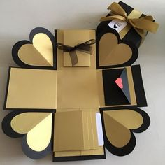 Buy DIY Explosion box with 4 waterfall, pull Tab and envelope in black & gold in Singapore,Singapore. A 2 layers DIY explosion box with ribbon and tag - a pull tab that allows you to put 7 photos - a waterfall that allows you to put 4 photos - an envelope Birthday Explosion Box, Birthday Box, Birthday Cards, Birthday Message, Boyfriend Anniversary Gifts, Diy Gifts For Boyfriend, Anniversary Ideas, Anniversary Cards, Exploding Gift Box