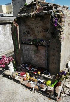 St Louis Cemetery There are three tombs that are each rumored to be the resting place of Voodoo queen Marie Laveau. Visitors leave offerings at one, two, or each of the three.New Orleans Marie Laveau, New Orleans Voodoo, New Orleans Louisiana, Altar, French Quarter, Fimo Kids, St Louis Cemetery, New Orleans Cemeteries, Wicca