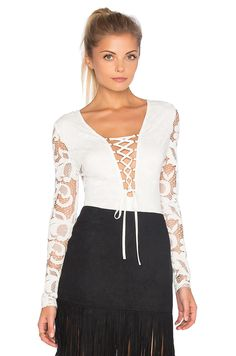 Shop for WYLDR High Speed Lace Bodysuit in Ivory at REVOLVE. Free day shipping and returns, 30 day price match guarantee. Lace Bodysuit, Revolve Clothing, High Speed, Bell Sleeve Top, Ivory, Tunic Tops, Blouse, Shopping, Women