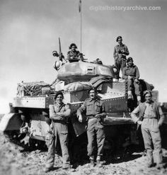 WWII, 1943 - This British tank crew just completed a successful drive on Tripoli, North Africa, 25 January 1943.
