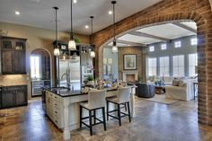 Arch to separate kitchen and living areas; brick