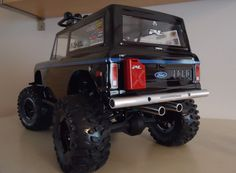 Lifted Black Ford Bronco Mudder Truck