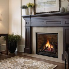 Gas Fireplace - recessed design with white surround with crown molding detail.