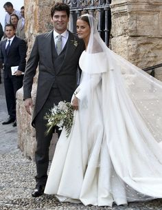 dailymail: Wedding of Lady Charlotte Wellesley, Church of the Incarnation, Illora, Spain, May 28, 2016-Lady Charlotte Wellesley, daughter of Charles Wellesley, 9th Duke of Wellington, and Princess Antonia of Prussia, and Columbian-American financier Alejandro Santo Domingo; the bride wore an off-the-shoulder bespoke gown in cream by designer Emilia Wickstead.