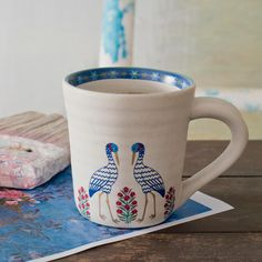 Hand thrown artisanal stoneware decorated with whimsical cranes, flower butahs, slender cypresses and blossoming trees from our Samarqand Collection, inspired by the Silk Road. Discover the Registan Stoneware collection on our #WebBoutique #SustainableLuxury #Samarqand #Stoneware