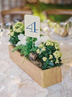 Rectangular centerpiece with table numbers | Vicki Grafton Photography | Theknot.com
