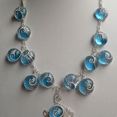 wire weaving jewelry | Blue woven snails jewelry | JewelryLessons.com