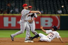 CrowdCam Hot Shot: Houston Astros second baseman Jose Altuve is out at second base as Cincinnati Reds shortstop Zack Cozart throws to first base during the first inning at Minute Maid Park. Photo by Troy Taormina