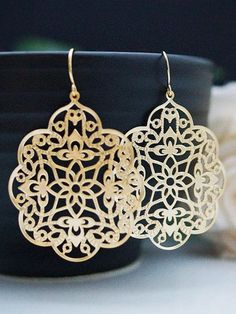 I like gold on earrings. That way it sort of looks like a maze and a compass in the middle.