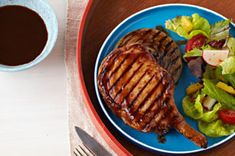 A duo of cola and KRAFT BBQ Sauce team up to make a delectably sweet and sticky sauce for these succulent grilled chops.