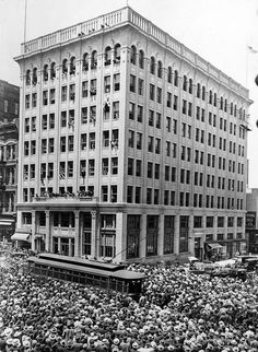 """On June 9, 1916, Harry H. Gardiner, called the """"Human Fly,"""" thrilled crowds as he climbed up the Omaha World-Herald building at 15th and Farnam Streets. While the 30,000 to 35,000 people gathered in the streets to watch gasped and shivered, the newspaper story said, Gardiner was unfazed. """"It seems all a part of a day's work to me,"""" he said. """"There's the wall with the little projections, ledges and places to which I must hold. And there's the top of the building, where I'm going to stop."""" According to the June 10, 1916, newspaper story, the enormous crowd was the largest in the history of Omaha to gather for such an exhibition. People in the streets were so numerous, they caused a massive traffic jam. THE WORLD-HERALD"""
