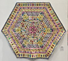 Sunshines Out, by Juliet Nelmes. Made with quarter-inch hexagons. Festival of Quilts, Birmingham UK, 2017 – Catherine Redford Hexagon Patchwork, Hexagon Quilt, Hexagons, Birmingham Uk, Golf Club Art, Embroidered Quilts, Miniature Quilts, Quilt Festival, Flowers