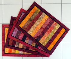 Handcrafted Striped Quilted Batik Table Mats priced to buy one at a time or mix and match a set  warm reds oranges yellows