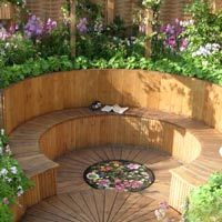 Curved raised bed with built-in bench