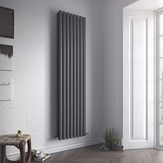 Eucotherm Nova Tube Vertical Designer Radiator - a single or double vertical oval tube radiator available in a white or anthracite finish. Upright Radiators, Tall Radiators, Vertical Radiators, Modern Radiators, Bathroom Radiators, Kitchen Radiators, Electric Radiators, Towel Radiator, Designer Radiator