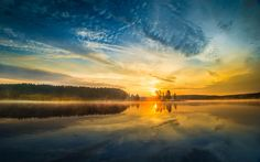 Woke up at to capture the sunrise on this lake in Yellowstone National Park. The mist subsided partially as the sun came up but was reluctant to leave, lingering on the surface for a while longer Uhd Wallpaper, Sunset Wallpaper, Landscape Wallpaper, Wallpapers, Wallpaper Backgrounds, Yellowstone National Park, National Parks, Sunrise Pictures, Sunrise Lake