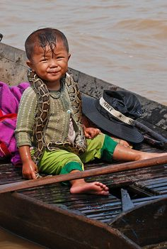 Asia 2011 - Cambodia, Floating Village, a boat came over offering to let you pose for pictures with one of their snakes. I politely declined. //  ari
