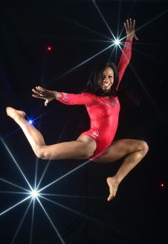 Olympic all-round gymnastics champion Gabby Douglas leaps into the air at the Team USA media summit in Los Angeles yesterday Artistic Gymnastics, Olympic Gymnastics, Gymnastics Girls, Olympic Games, Usa Gymnastics Team, Us Olympics, Rio Olympics 2016, Summer Olympics, Black Gymnast