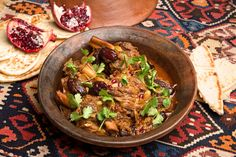 NYT Lamb Tangine -- For the best stews, use lamb shanks simmered slowly on the bone Here, Moroccan seasonings mingle for a bright balance of flavors: sweetness comes from dates and onions, and heat and spice from ginger and cumin This tagine is traditionally accompanied only by warm whole wheat pita or Arab flatbread