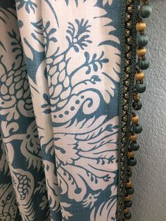 Pinched pleat drapery panel with leading edge beaded trim - This sample can be seen in our Englewood showroom