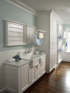 Cottage Laundry Room with Madison Fold-Down Wall-Mounted Laundry Drying Rack, Hardwood floors, Wainscotting, Crown molding
