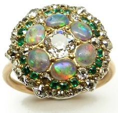 Antique opal, diamond, and emerald cluster ring, formerly a button. Circa 1820. Via Diamonds in the Library.