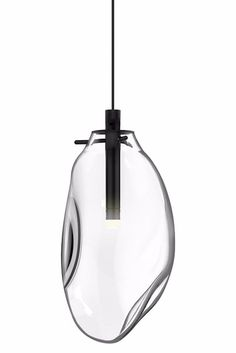 The Liquid LED Pendant by SONNEMAN Lighting presents an organic form of glass, which appears to be soft and melting.