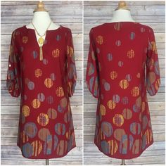 """Burgundy print shift dress, S M L LOVE THIS!!  Large  Circle print dress  tiny v cut in neckline  100% polyester  excellent quality  small bust 34 waist up to 34 hips up to 36  Medium  Bust 36 waist up to 36 hips up to 38  Large bust 38 waist up to 38 hips up to 40   length from shoulder seam down 34"""" Boutique Dresses"""