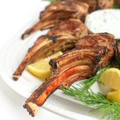 A fast 15 minute meal, your family will love these tender, grilled lamb chops served with a cool and creamy Greek tzatziki yogurt cucumber sauce. Greek Marinated Lamb Chops with Tzatziki Marinated Lamb, Grilled Lamb Chops, Kitchen Recipes, Cooking Recipes, Healthy Recipes, Ketogenic Recipes, Delicious Recipes, Keto Recipes, Rosemary Lamb Chops